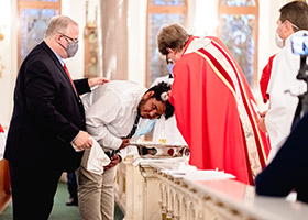 Father John Robert Skeldon baptizes a new member of the Church at the Pentecost Vigil Mass on May 30. (NTC/Kenneth Munyer)